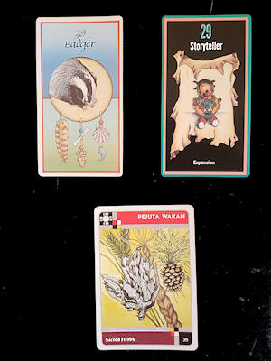 a card from each of 3 native-based oracle decks