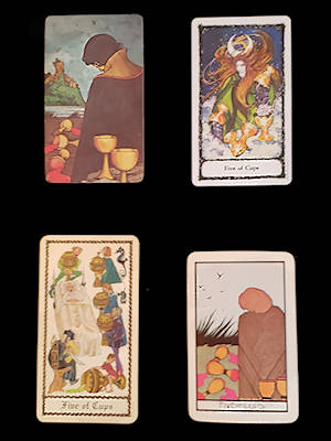 the 5 of Cups card from each of 4 decks